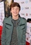 Jake Short - smiling, gray-green jacket